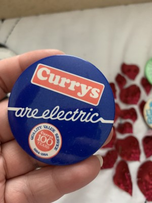 Currys badge