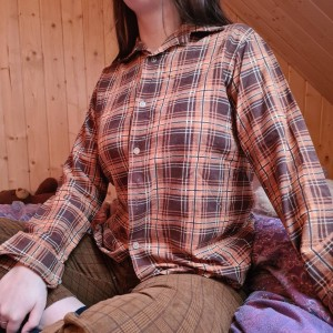 brown and orange flannel shirt