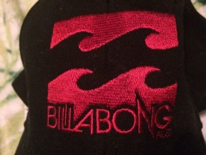 Red and black Billabong baseball cap - Unused with tag still on it