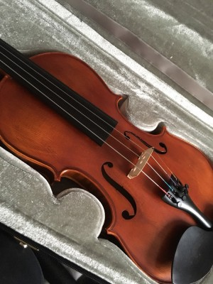 violin with lesson book and rosin