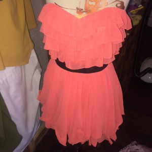 pink ruffle dress with black belted round waist