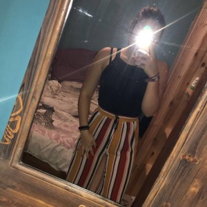 Flowy multicoloured stripy trousers