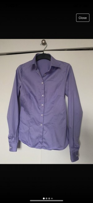 Smart lavender flattering fitted blouse with collar and cuffs