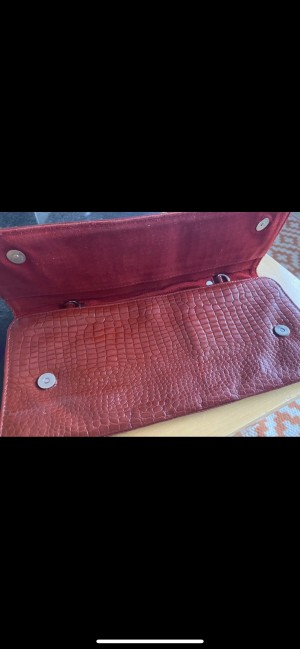 Red leather croc clutch bag