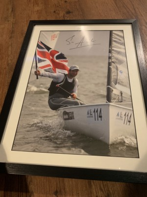 Signed sailing poster in frame