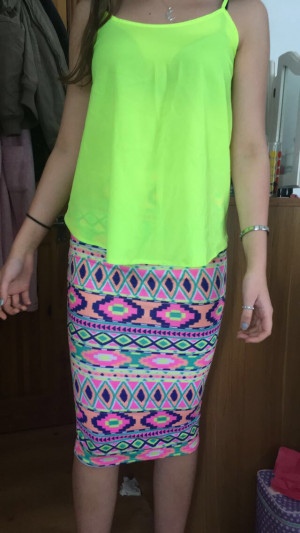 Skirt , patterns on (£10) , if you want to buy the top with it it's (£12) together