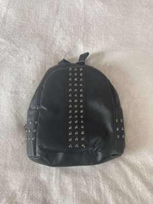 Metal detailed backpack