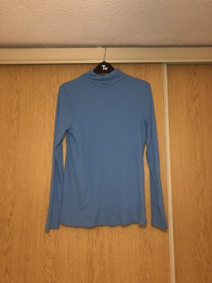 Blue turtle neck top, size 10