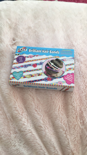 Hair band making kit includes to sets of hair flowers, three black hair bands,small gems and fabric strips (12 different colours)