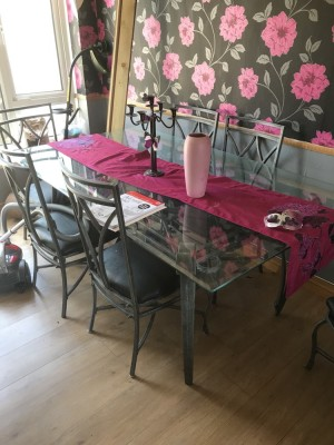 Cast iron dinning room table and six chairs chairs need recovering strong glass