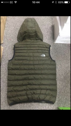 Dark green north face body warmer