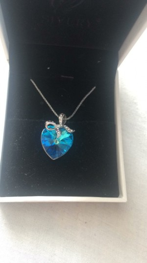 Blue heart shaped crystal necklace on silver chain
