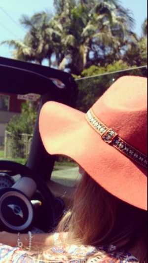 orange floppy hat