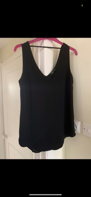 Oasis black floaty vest with vest style straps, matching front and bac